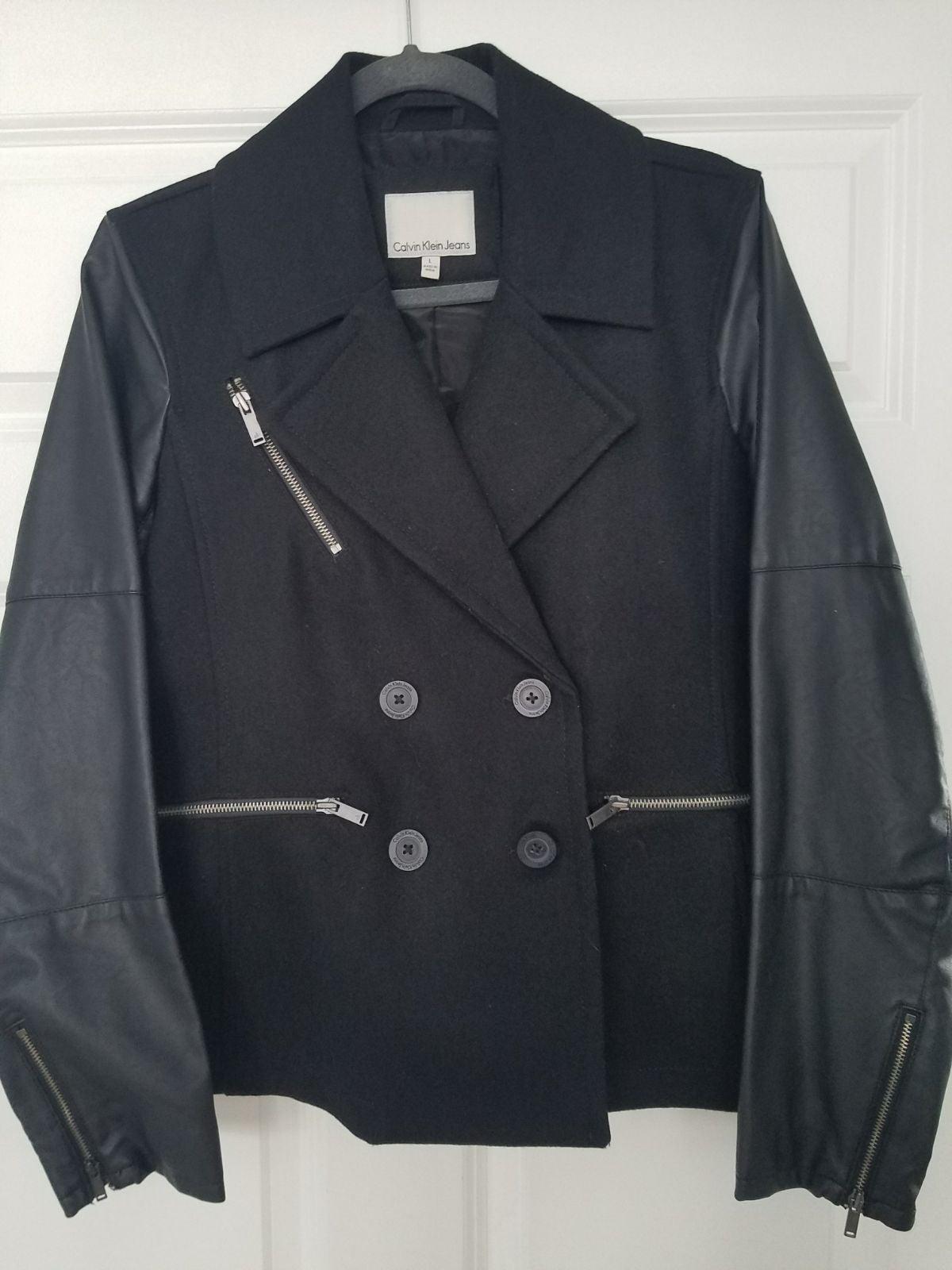 Calvin Klein Coat. Size Large. Lots of n