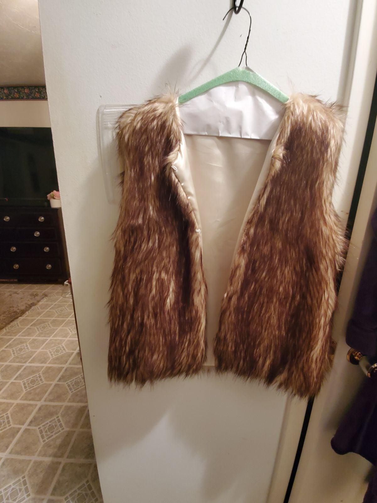 Faux Fur Vest New never  worn