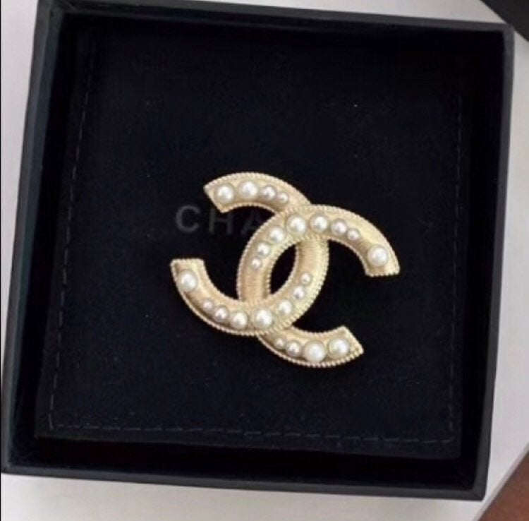 Chanel logo brooch