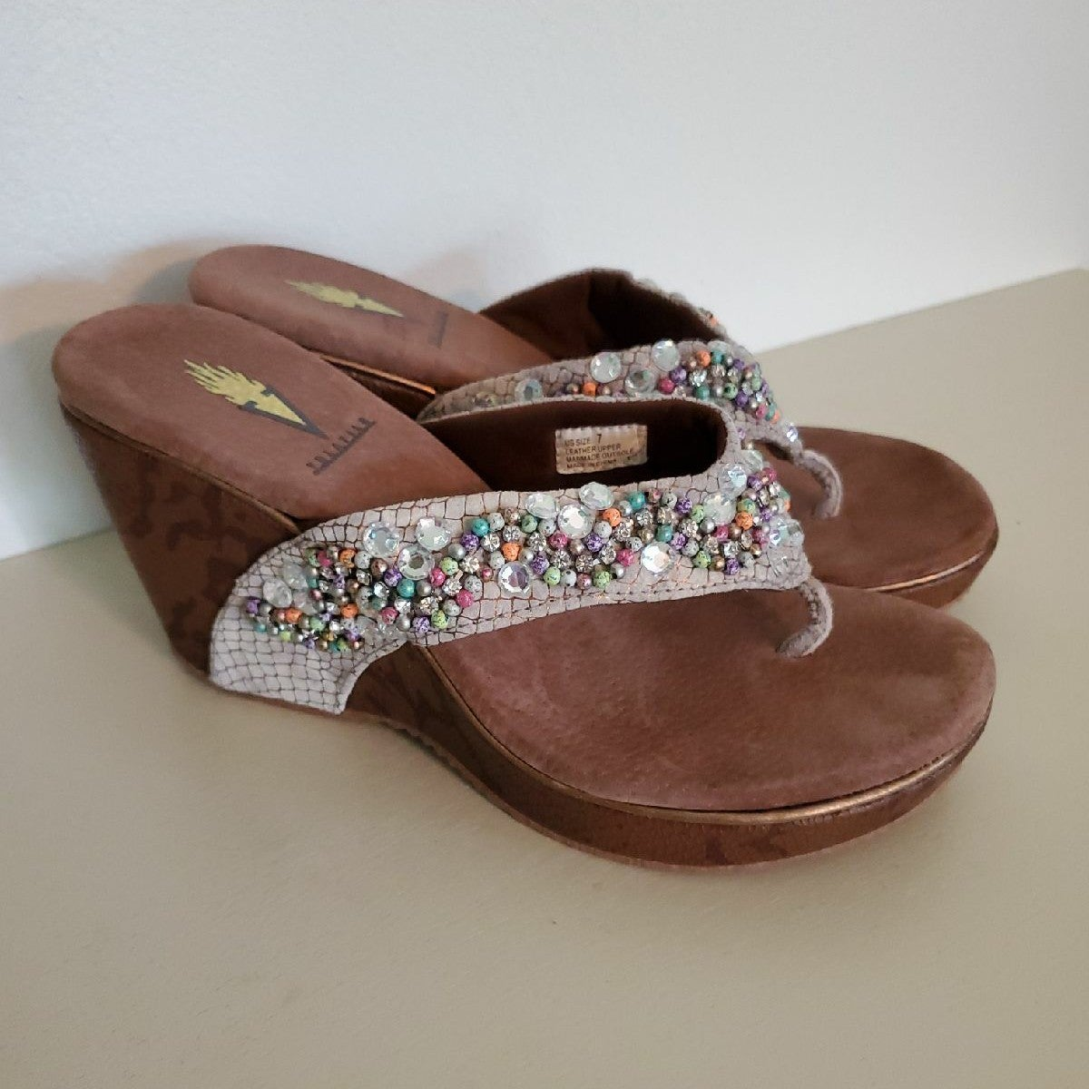 Volatile beaded wedge sandals