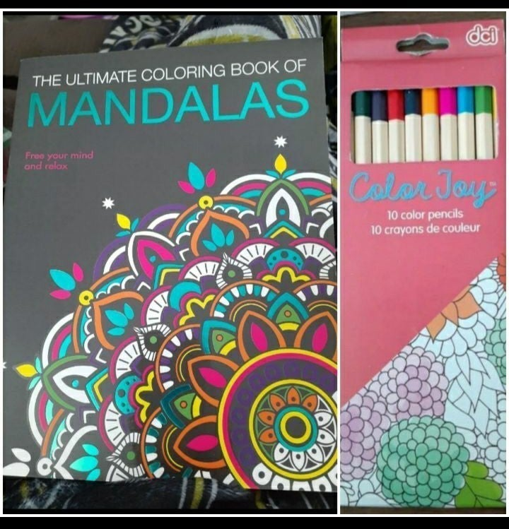 Adult coloring book and colored pencils