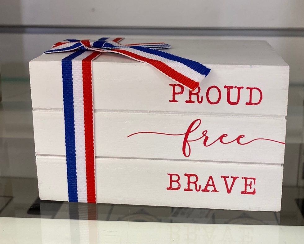 Proud Free Brave wooden bookstack