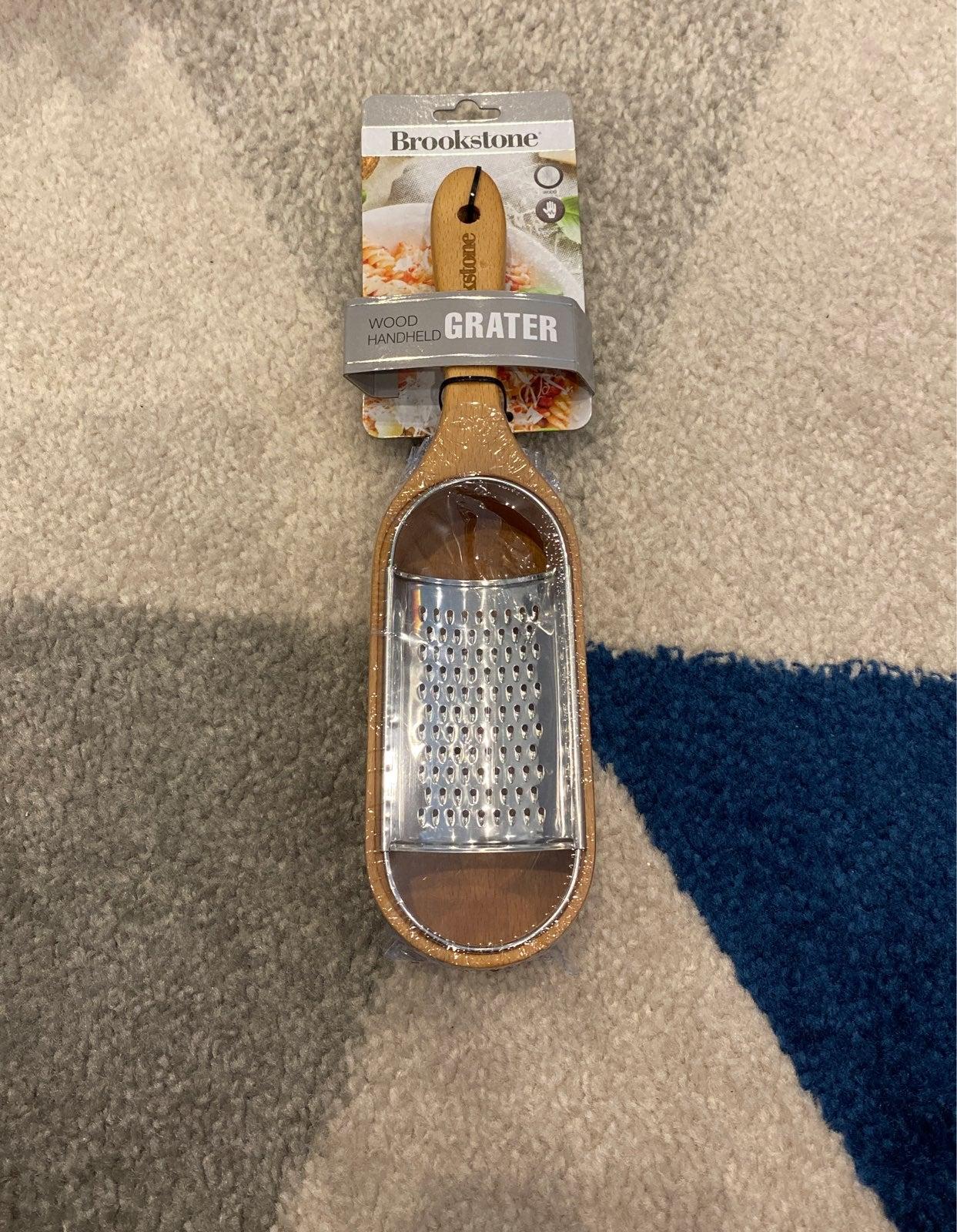 Brookstone wood handheld grater