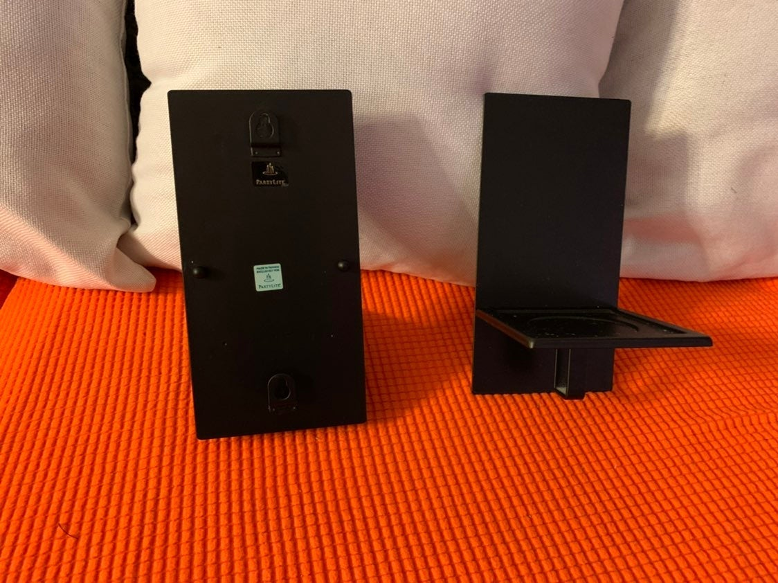 Pair of elephant and brass candle holder