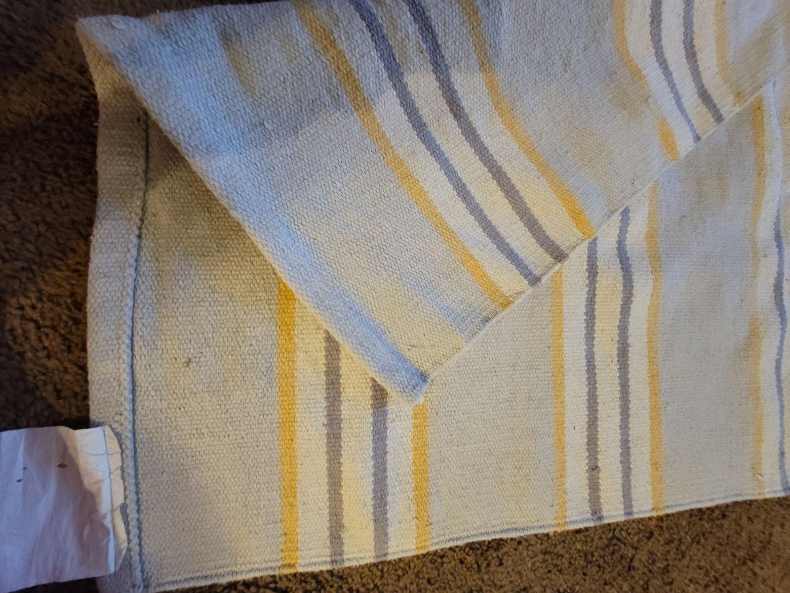 Gray and yellow rug