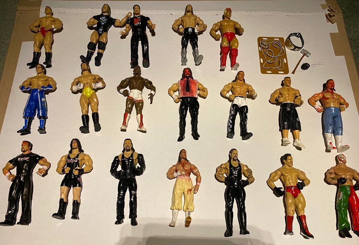 Lot of 19 WWE Action Figures