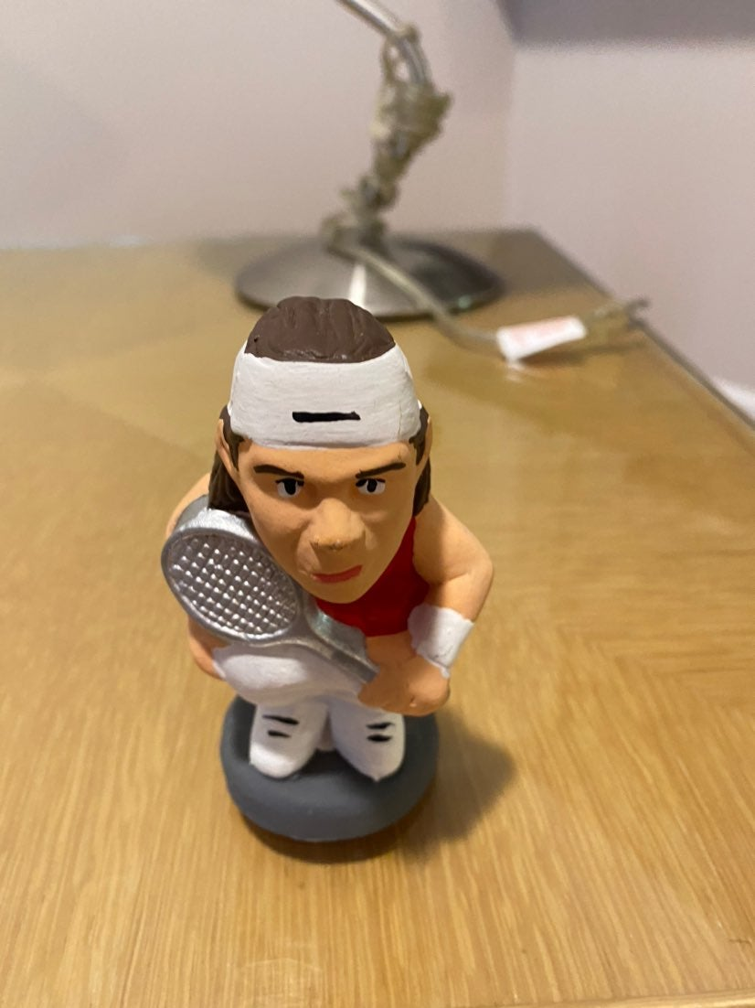 Federer and Nadal poop statues