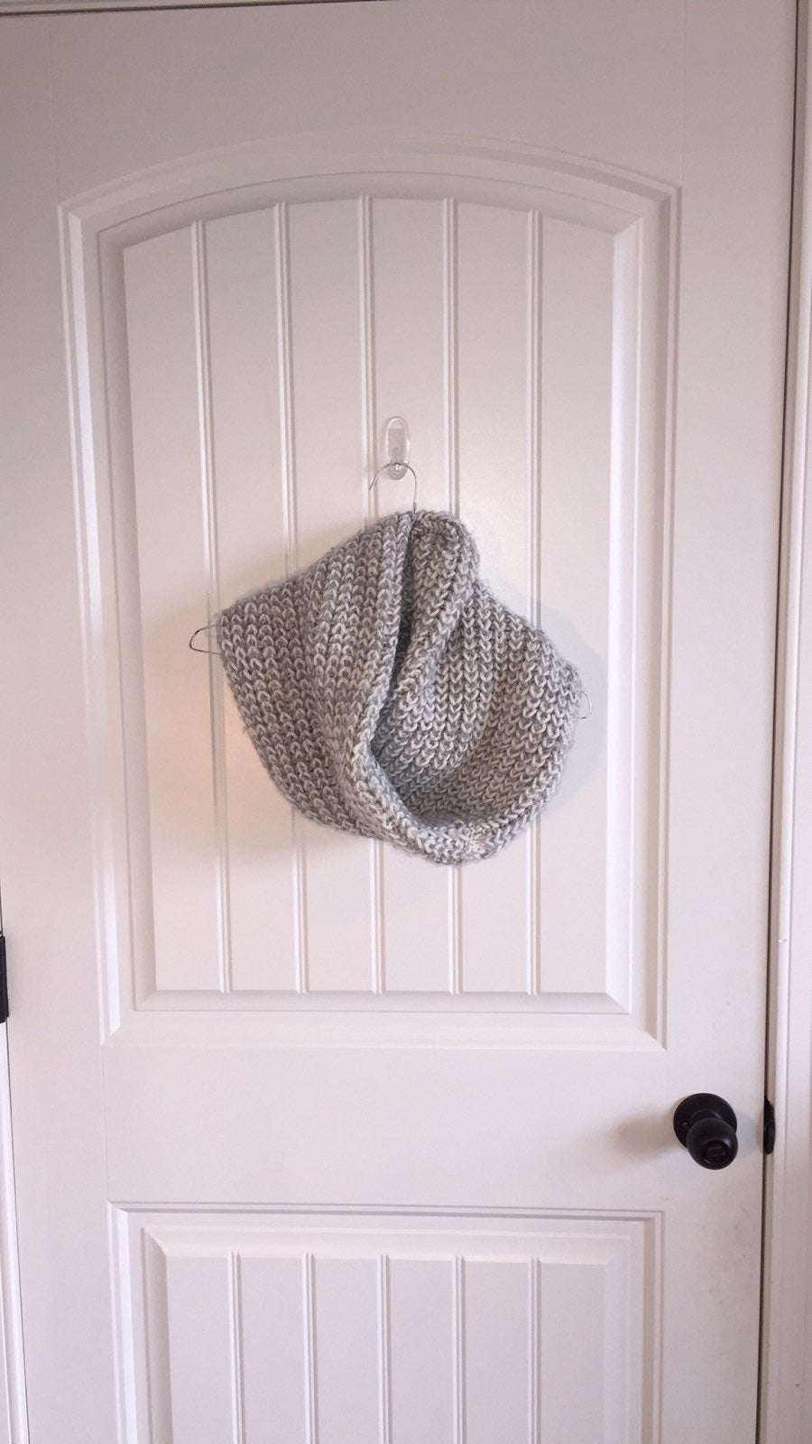 knitted gray and white infinity scarf