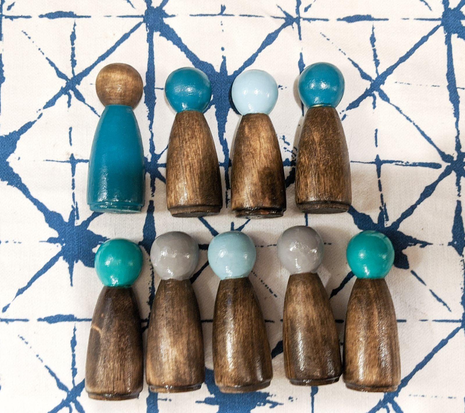 Set of 9 wooden peg dolls