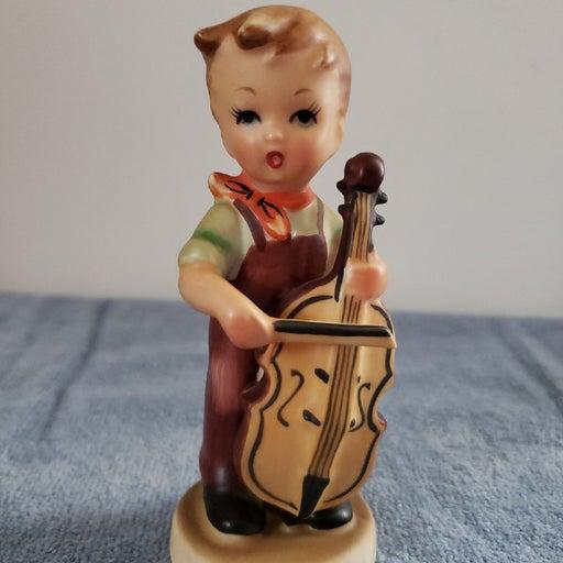 Hummel Lookalike Boy With Cello