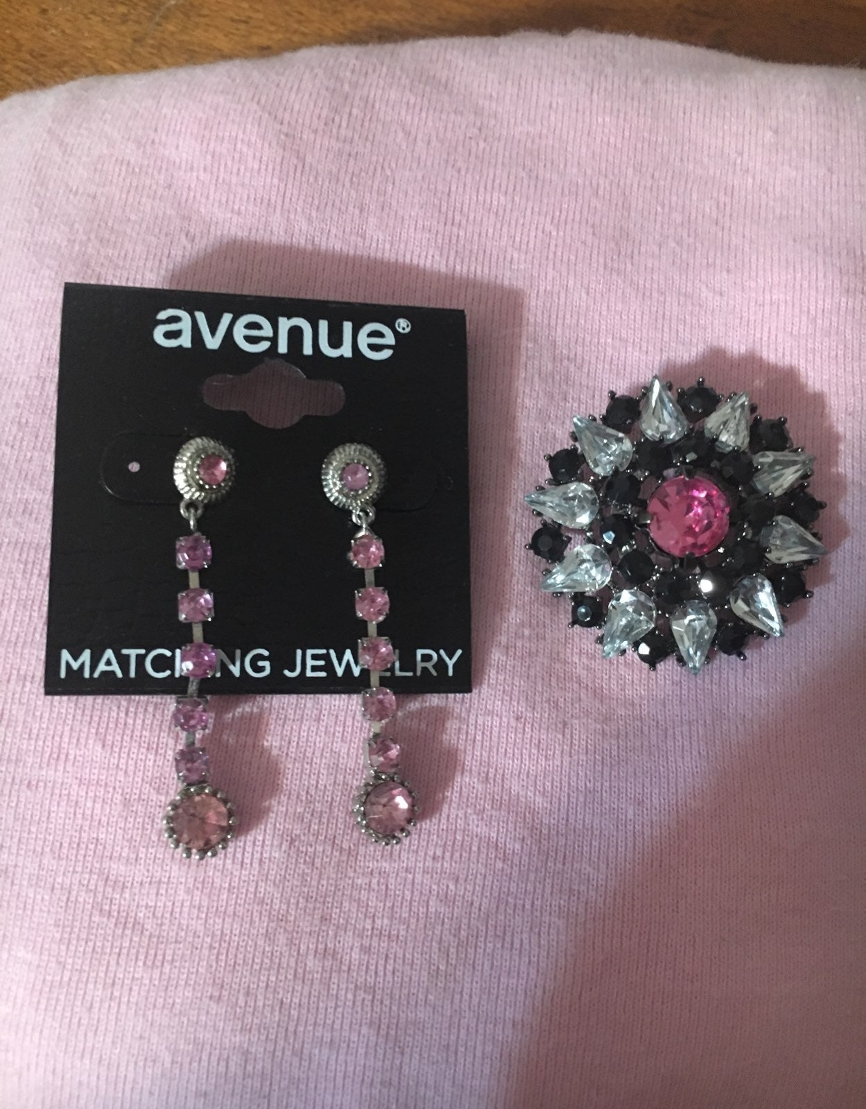 A pair of earrings and a pin