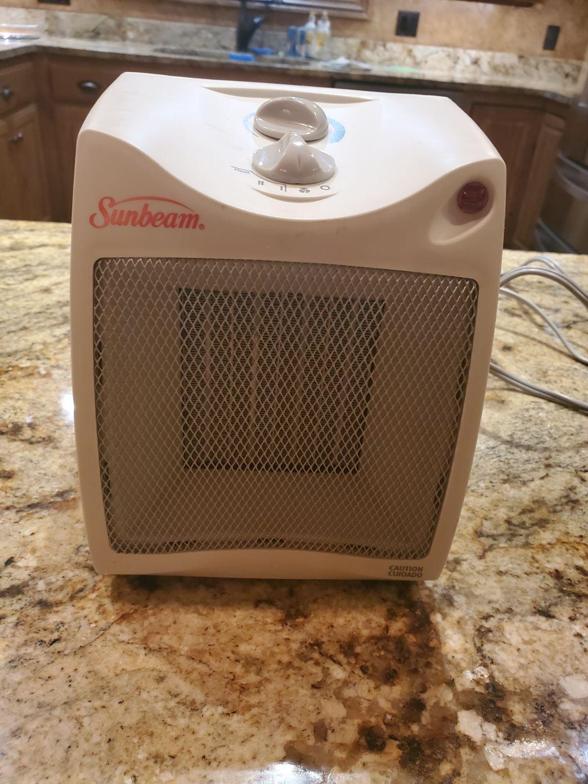Sunbeam compact fan and heater