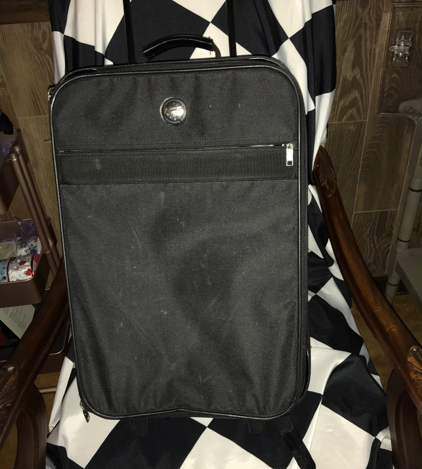 American Tourister carry on roller bag