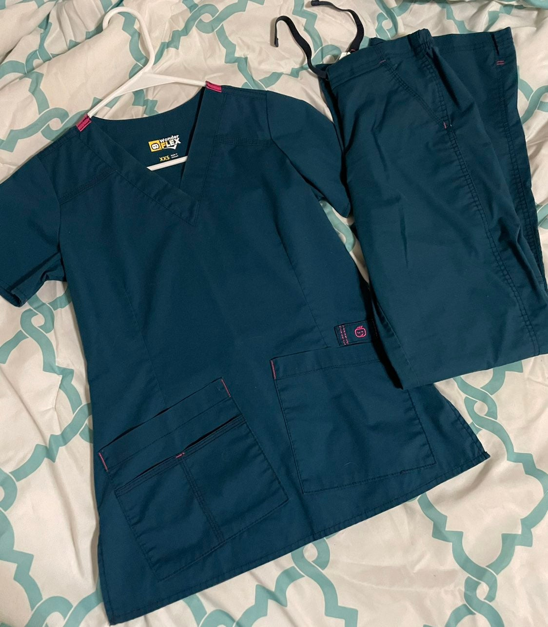 Two pairs of scrubs