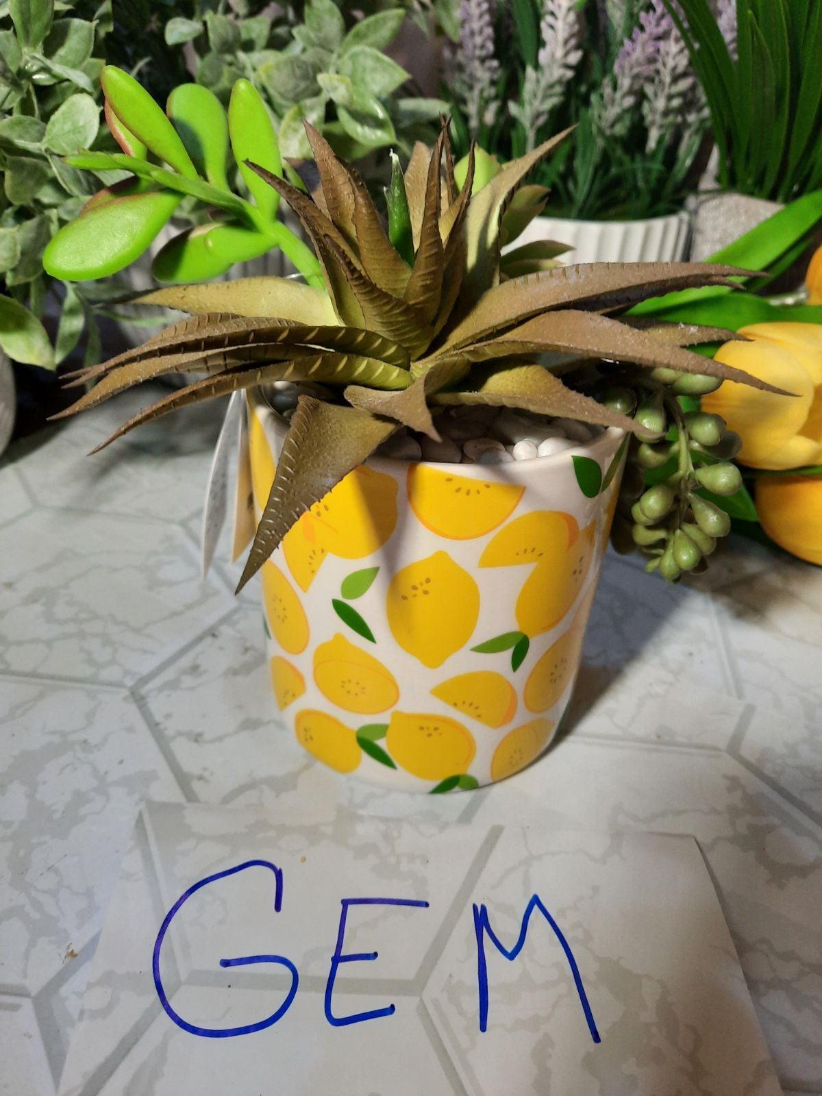 Faux plant in lemon pot