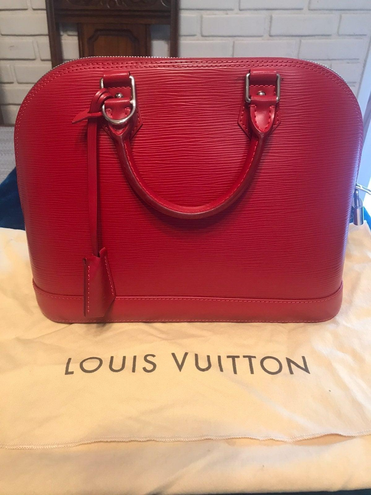 Authentic Louis Vuitton red Alma PM bag