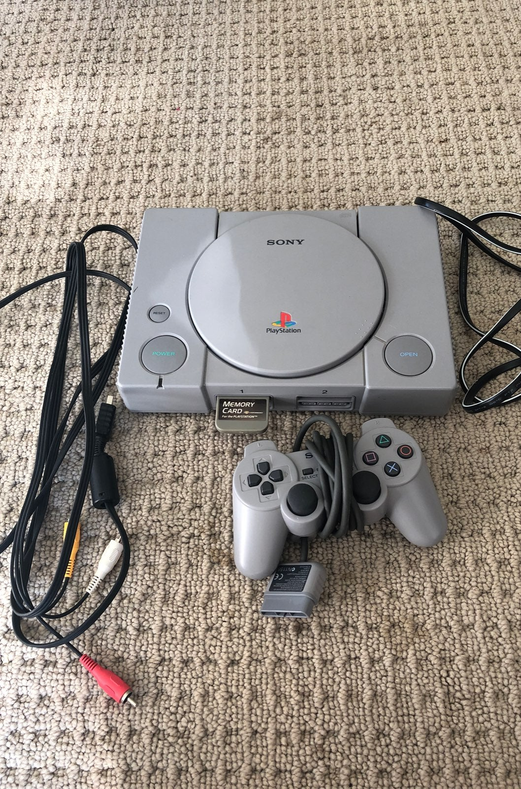 PlayStation 1 with controller and memory