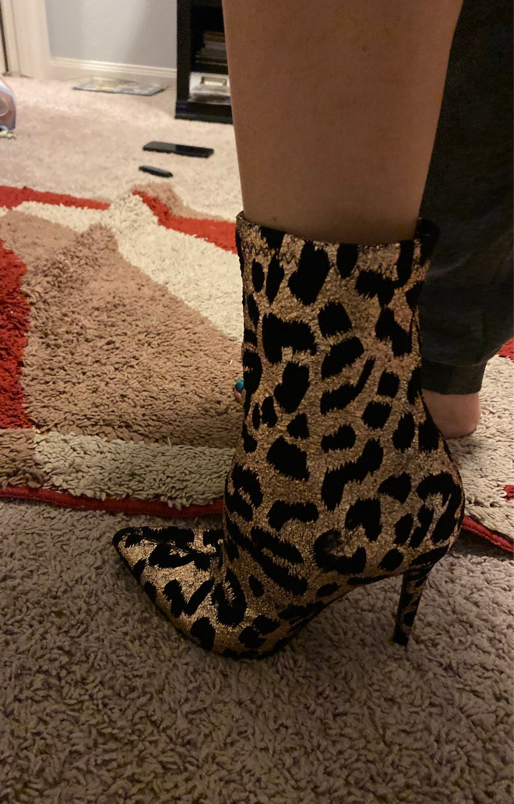 Gold and black stiletto ankle heels
