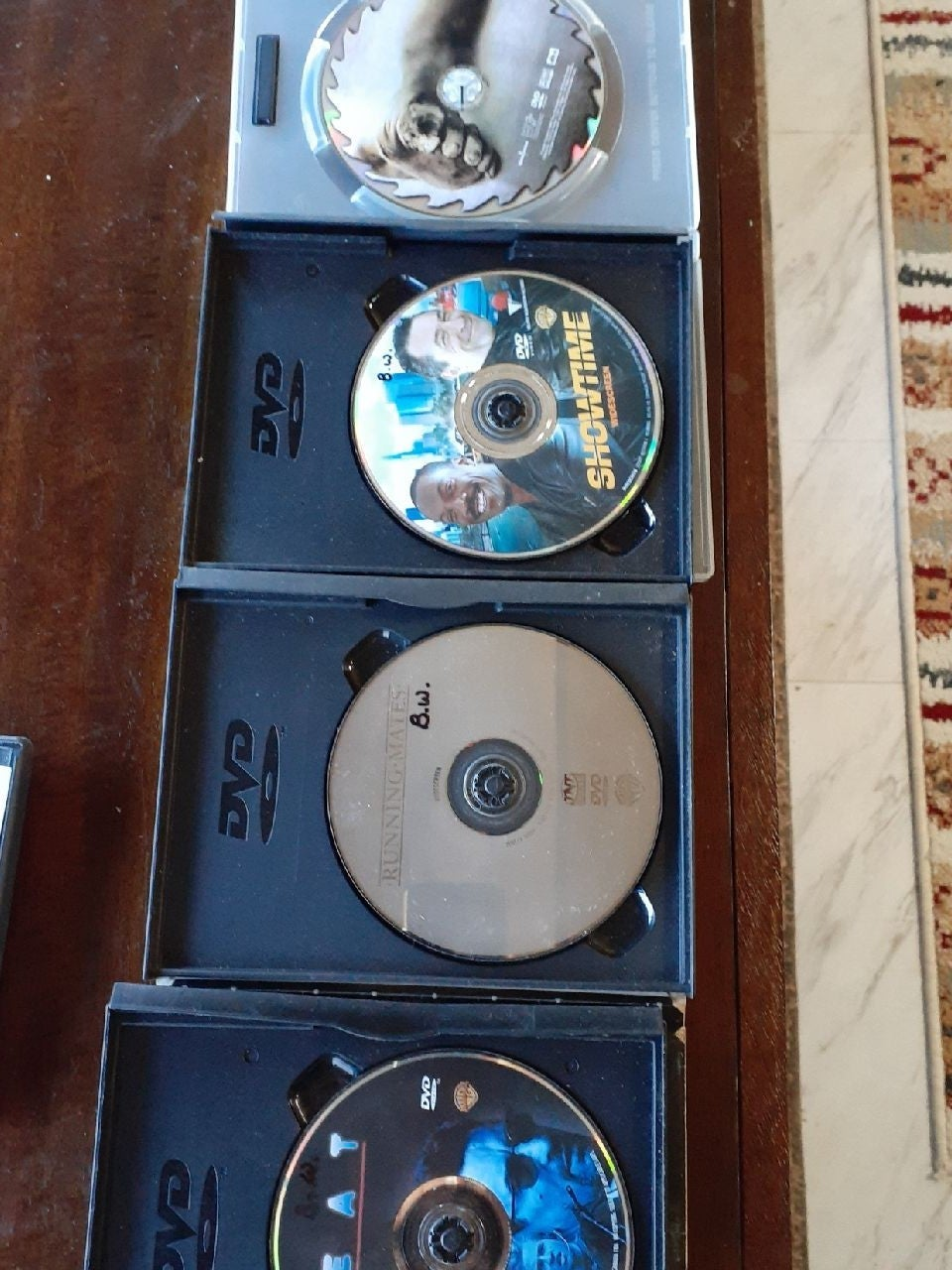Saw, showtime and two other dvd movies