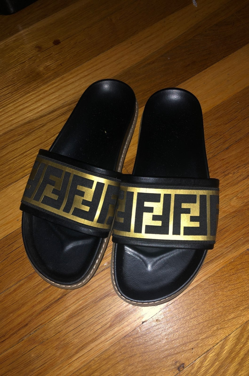 Womens black & gold printed slides sz 40