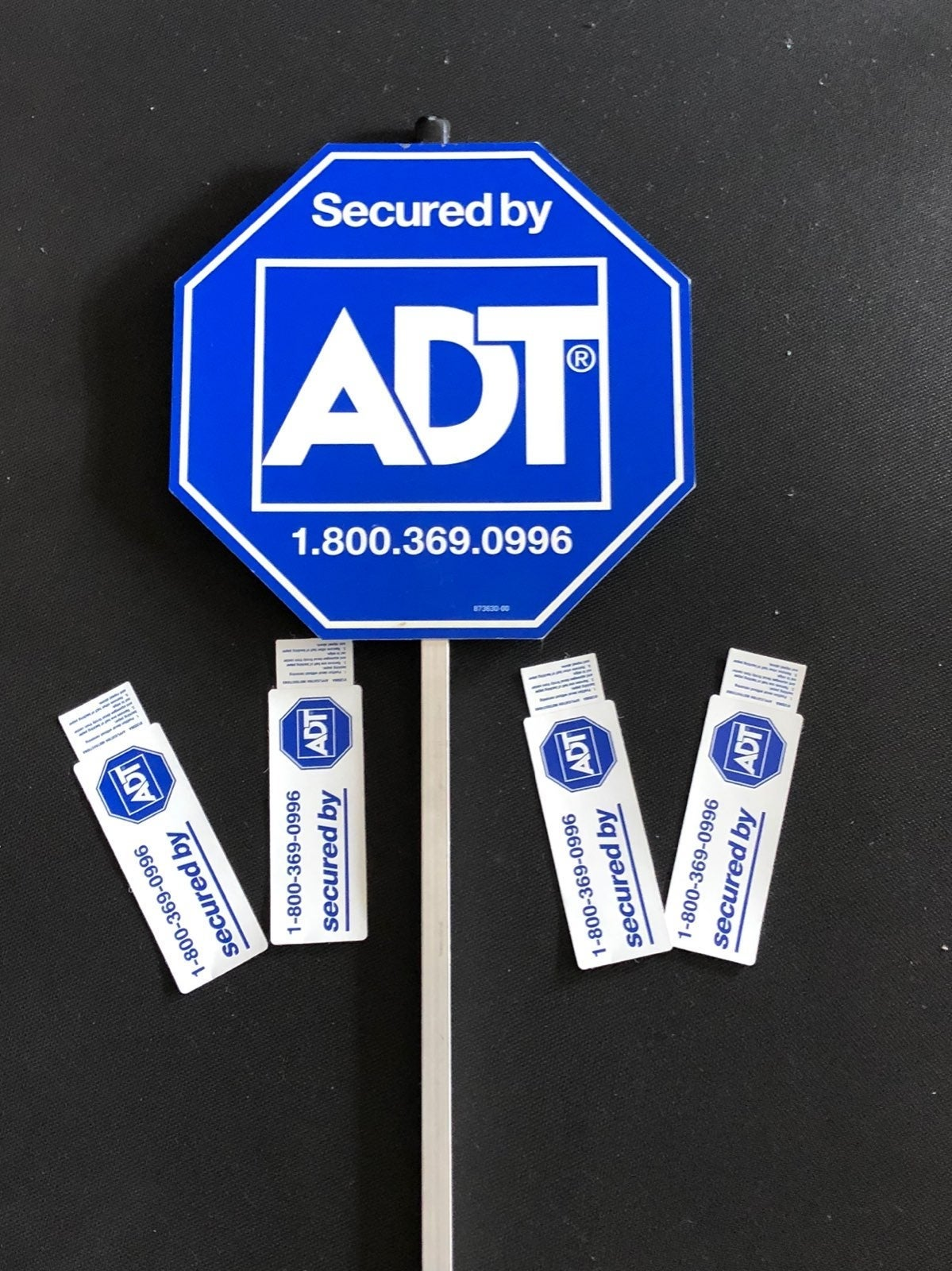 ADT sign and 4 window stickers