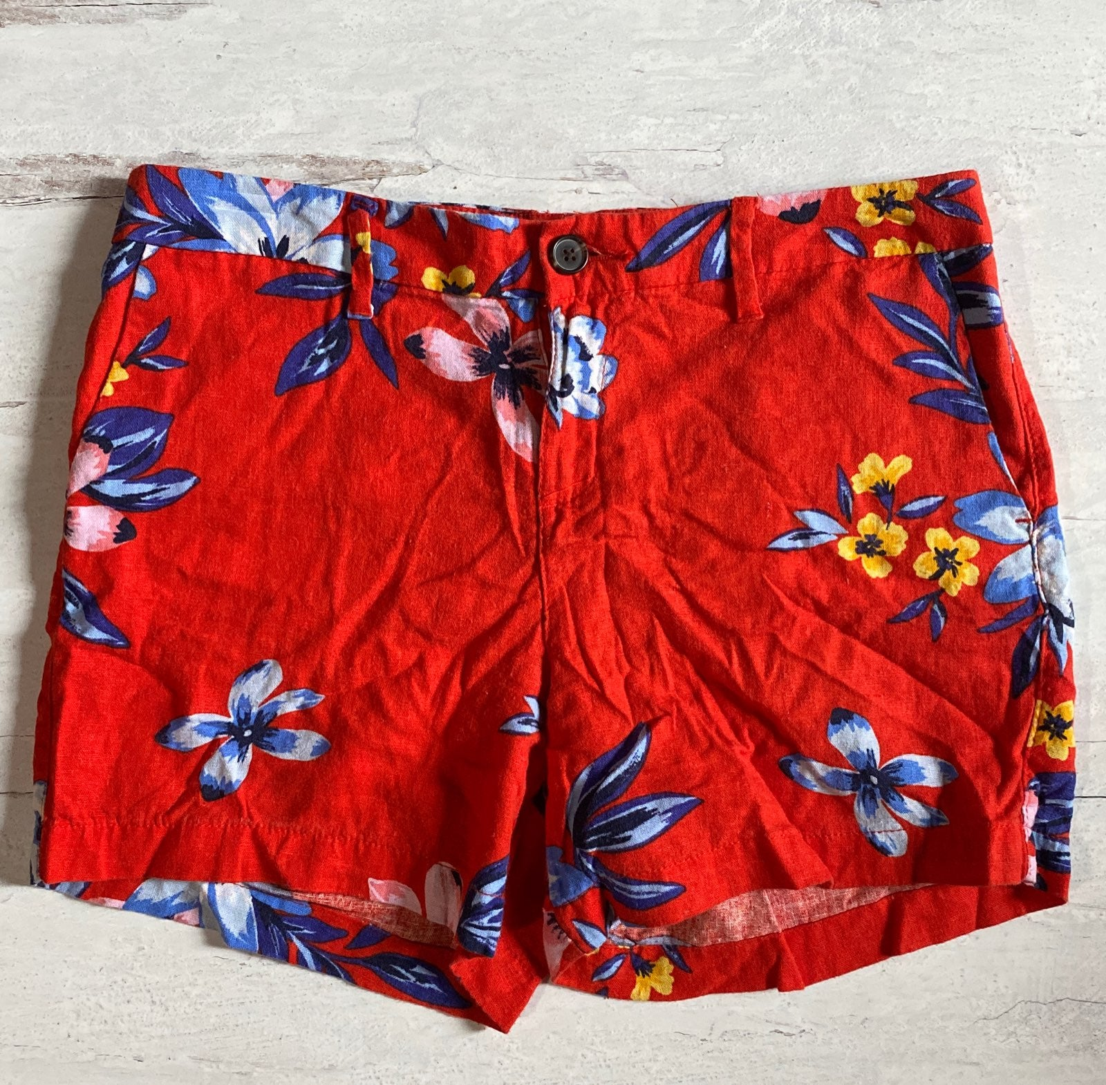 Red floral tropical shorts