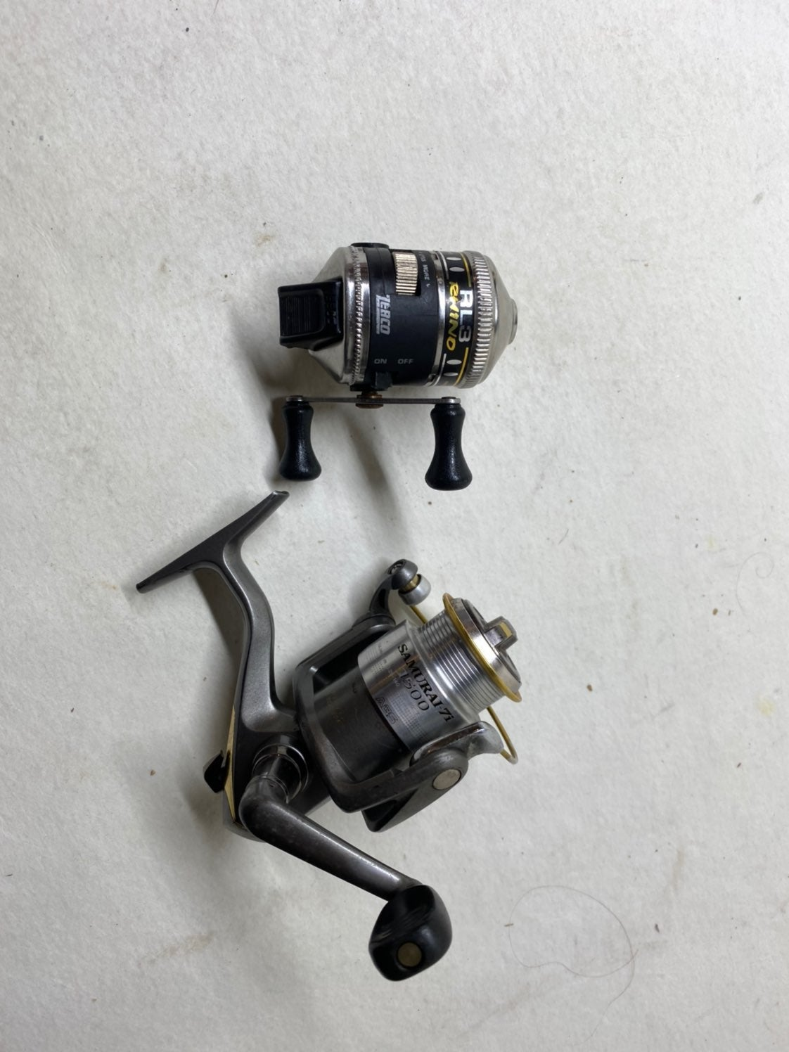 Two fishing reels Zebco and ...