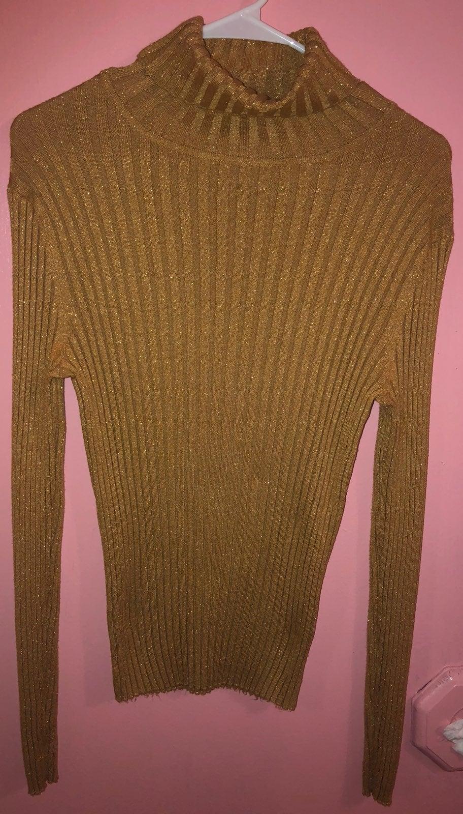 Turtleneck gold sweater
