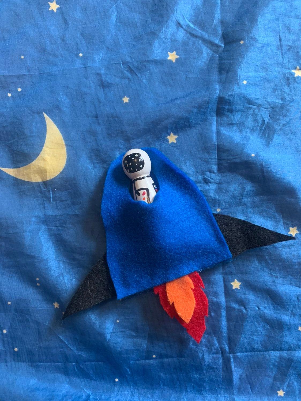 Wooden astronaut with royal blue felt ro