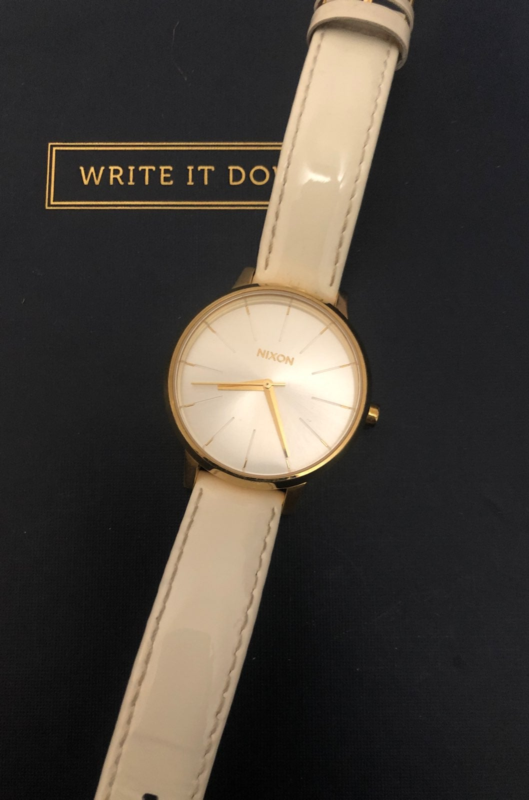 Nixon gold and white watch