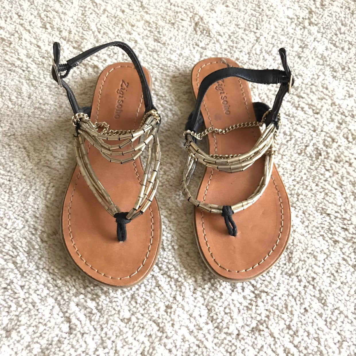 Black and gold sandals
