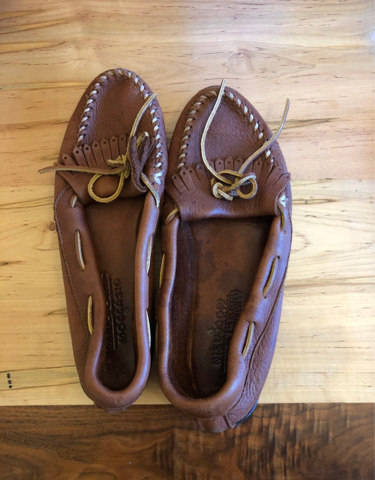 minnetonka moccasins. Red brown leather